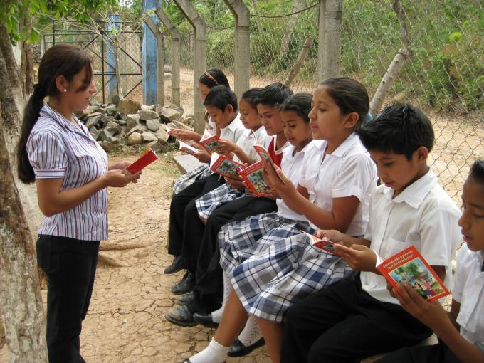Students of a community school learn how to prevent human trafficking by reading a child friendly material. Photos by Michael Bisceglie